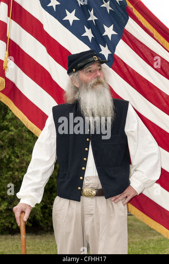 MODEL RELEASED A Union soldier in a Civil War reeanctment in front of the flag - Stock Image