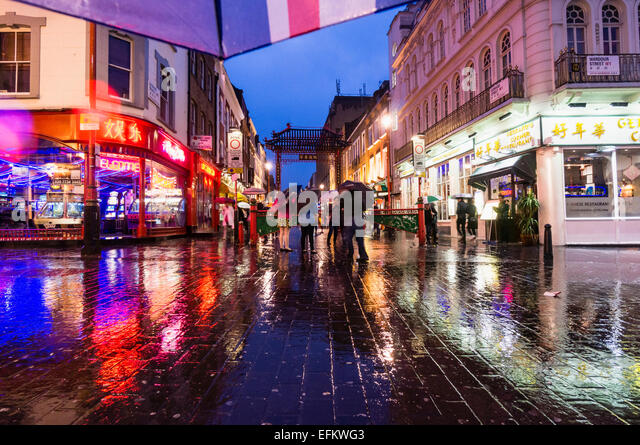 Gerrard Street  Chinatown a rainy evening, London , UK - Stock Image