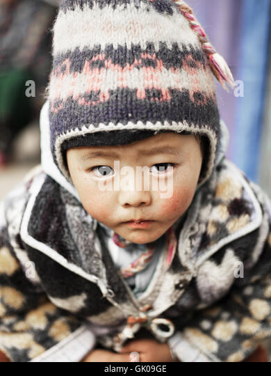 A small native child in Lukla, Nepal - Stock Image