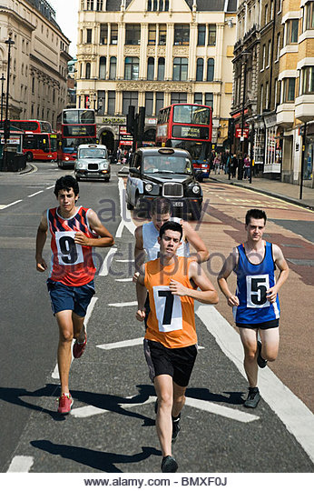 Runners on road in london - Stock Image