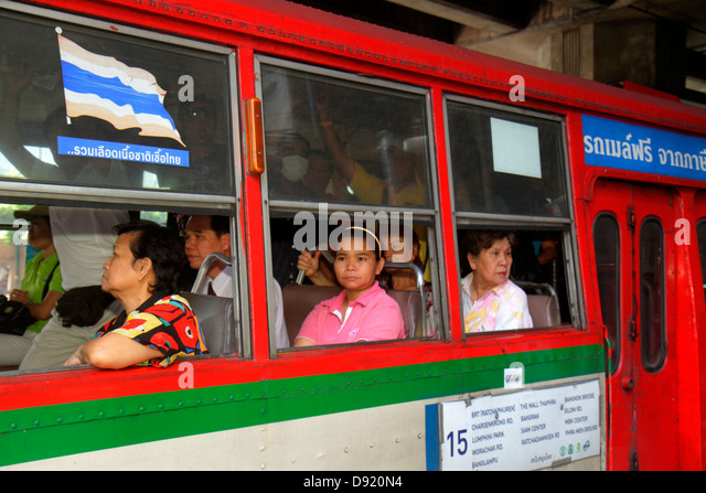 Thailand Bangkok Pathum Wan Rama 1 Road bus passengers public transportation Asian woman - Stock Image