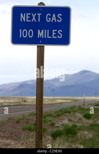 Next gas 100 miles road sign at the Oregon/Nevada border in McDermitt, USA. - Stock Image