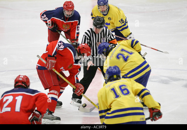 Face off at an ice hockey game between team Sweden and team Russia in an international tournament for 17 year old - Stock Image