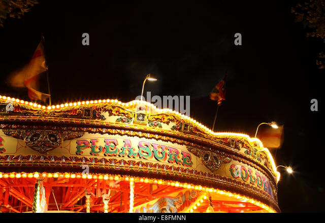 United Kingdom, England, London, View of carousel at night - Stock Image