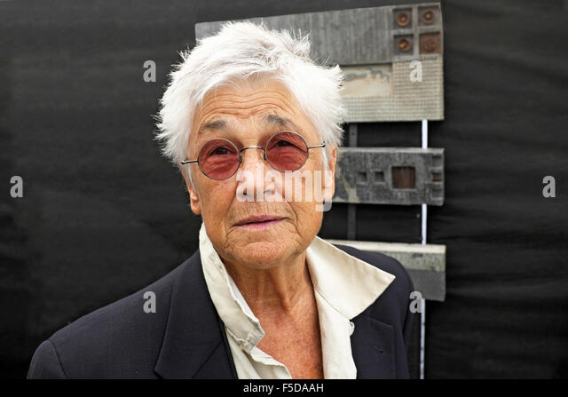 A middle-aged woman with very short hair wearing tinted glasses. she is artist Grayson Malone. - Stock Image