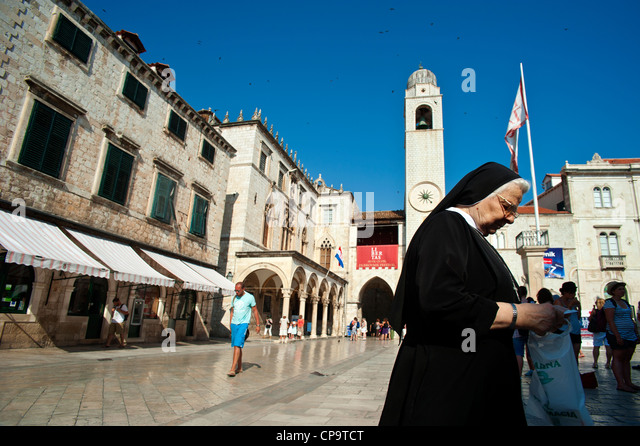 Main street Stadrun, Sponza Palace and Bell Tower in Luza Square , Old Town, Dubrovnik. Croatia. - Stock Image