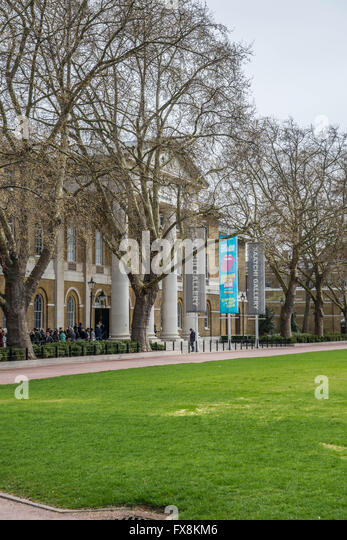 Visitors make their way into the Rolling Stones exhibition at the Saatchi Gallery, London, - Stock Image