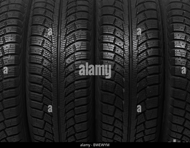 Closeup of a winter car tires background texture - Stock Image