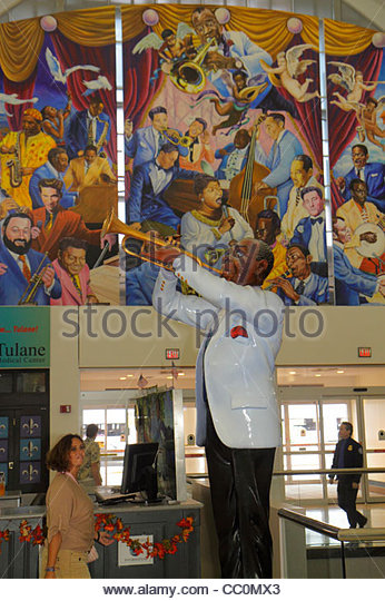 New Orleans Louisiana Louis Armstrong New Orleans International Airport MSY terminal sculpture Louis Armstrong Satchmo - Stock Image