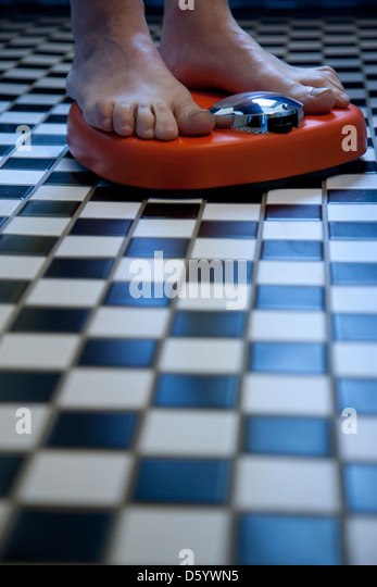 Close up of Feet on Weighing Scale - Stock-Bilder