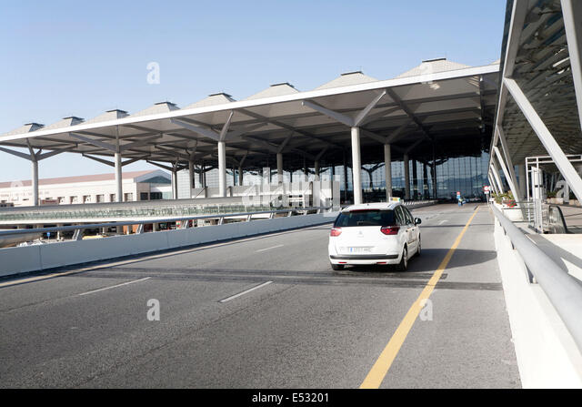 White taxi car arriving at Malaga airport, Spain - Stock Image