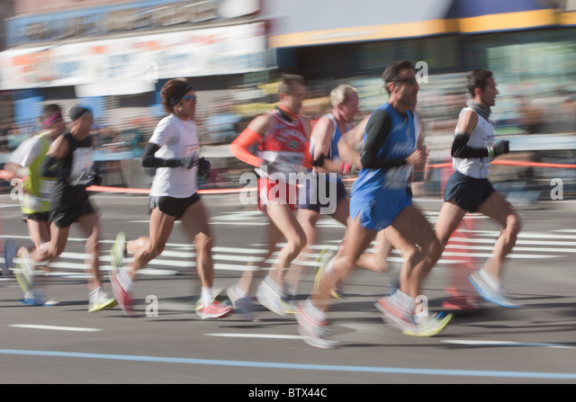 Blurred abstraction of runners in the 2010 New York City Marathon. - Stock Image