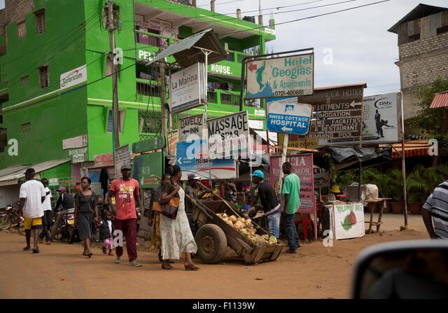 Advertising hoardings and billboards in street Mtwapa Mombasa Kenya - Stock Image