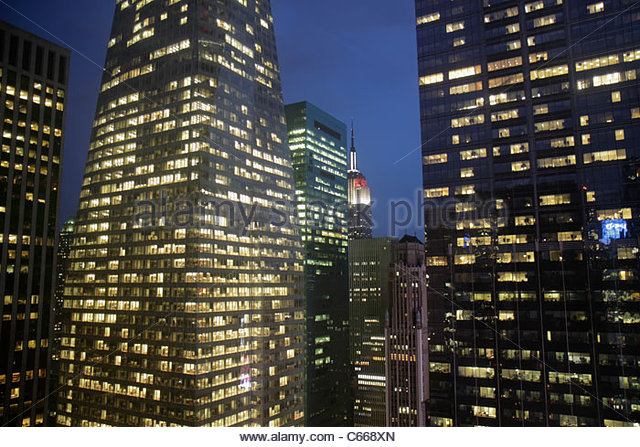 New York New York City NYC Midtown Manhattan Bank of America Towers skyline skyscrapers office buildings lights - Stock Image