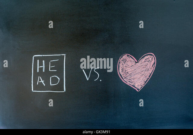 head and heart symbols drawn on a chalkboard. - Stock Image