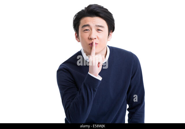 Young man with finger on lips - Stock Image