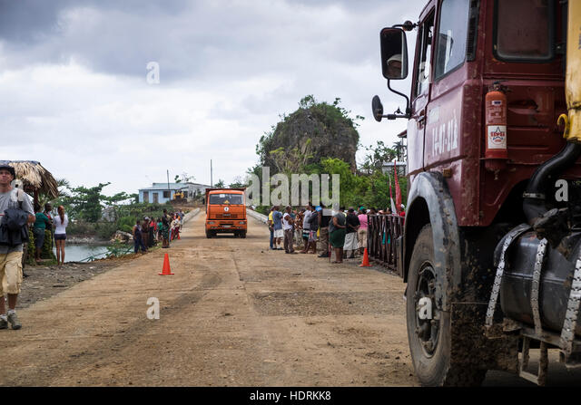 Trucks delivering materials for the relief efforts after hurricane Mathew, Yomuri, Baracoa, Cuba - Stock Image