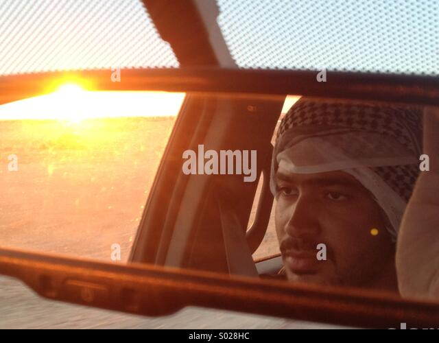 Egyptian man driving at sunset - Stock Image
