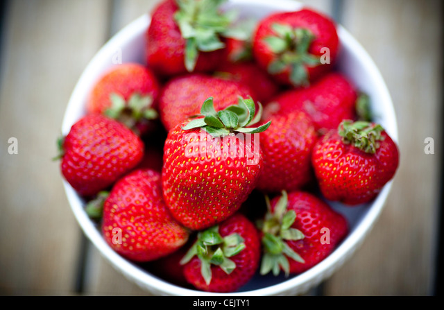 Strawberries in a bowl - Stock Image