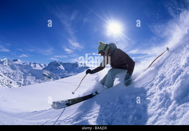 Woman skiing in Lech, Austria. - Stock Image
