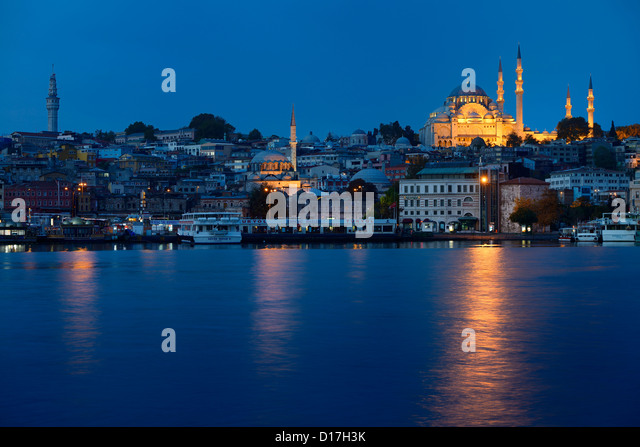 Beyazit tower Rustem Pasha and Suleymaniye Mosques at dawn on the Golden Horn Istanbul Turkey - Stock Image