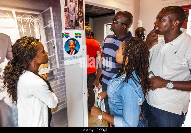Johannesburg South Africa African Soweto Vilakazi Street Precinct Nelson Mandela home museum inside Black woman - Stock Image