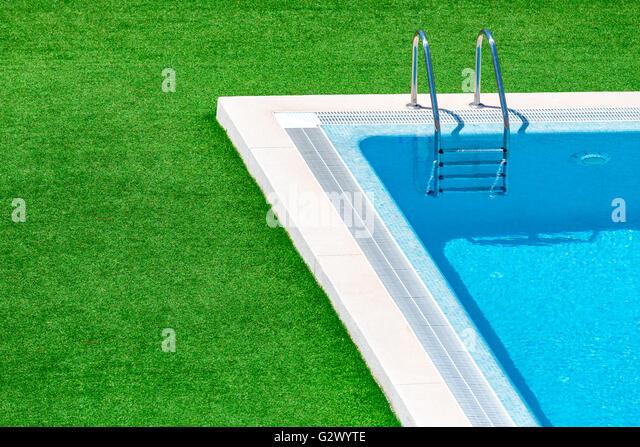 Swimming pool with stair in hotel resort - Stock-Bilder