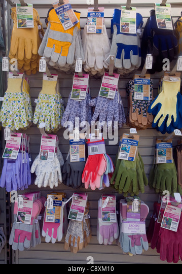 Gardening is a major leisure industry as suggested by this display rack of garden gloves in different styles and - Stock-Bilder