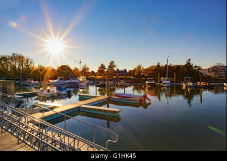 Millway Marina, Barnstable, Cape Cod, Massachusetts in the fall autumn with sunburst wooden boats, clear blue sky, - Stock Image