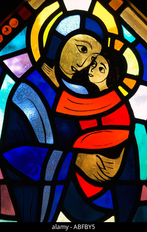 A stained glass window of mary & jesus in the chapel at the benedictine monastery of Abbaye de St Benoit du Lac in Estrie Quebec - Stock Image