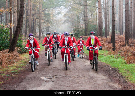 Fund-raisers dressed as Santas cycled in the 'Santa Cycle', part of the annual 'Santa Dash' to raise - Stock Image