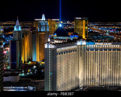 High view of  hotels and casino lights on the Strip from above lit up at night, Las Vegas Nevada USA, nightlife, February 2015. View of casinos and hotels includes the Mandalay Bay, Monte Carlo, Luxor hotel and casino, Delano and New York New York. February 2015. - Stock Image