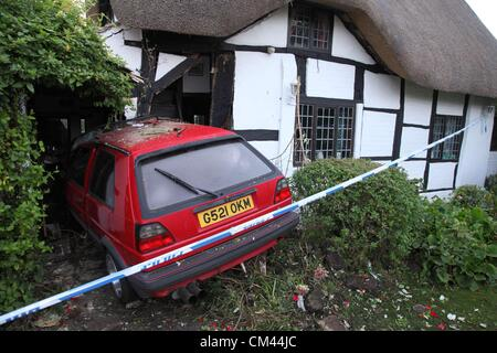 A Volkswagen Golf demolished the corner of Hornby Cottage, a listed cottage in Welford on Avon, Warwickshire - Stock Image
