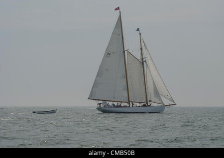 The Brilliant, a schooner from Mystic, Connecticut operated by Mystic Seaport, under sail as the Parade of Ships prepares to head out of Niantic Bay toward New London, Connecticut during OpSail 2012 CT. - Stock Image
