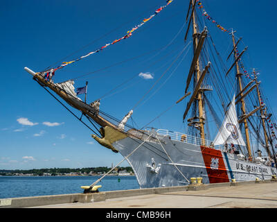 New London, Connecticut, USA - July 9, 2012: The US Coast Guard training ship Eagle moored at Fort Trumbull on the last day of OpSail 2012 CT, celebrating the bicentennial of the War of 1812 and the penning of the Star Spangled Banner, the US National Anthem. - Stock Image