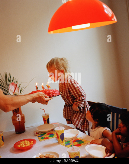 A three years old girl having a birthday party, Sweden. - Stock-Bilder