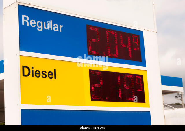 Gas station sign advertising very low prices at a gasoline station. - Stock Image