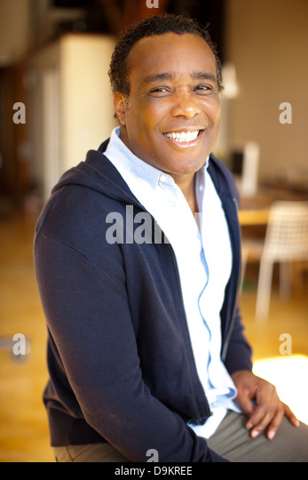 Man posing with charismatic smile and look of happiness - Stock Image