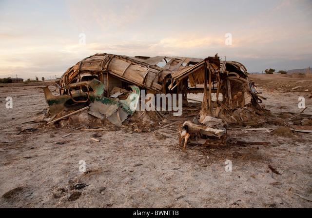 Derelict trailer corroding away at the Salton Sea. - Stock Image