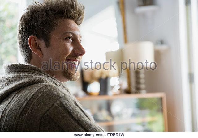 Smiling brunette man looking away - Stock-Bilder