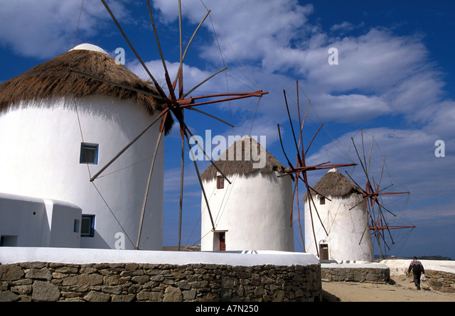 GREECE Mykonos white windmills thatch roofs national symbol iconic image blue sky background - Stock Image