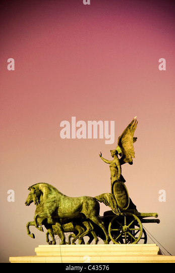 Statue of Goddess Victory, Vittorio Emanuele II Monument (Il Vittoriano), Rome, Italy (SUNSET FILTER) - Stock Image