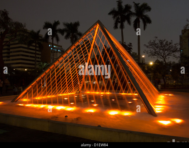 Illuminated fountains at dusk in Magic Water Circuit Tour / El Circuito Mágico del Agua in Reserve Park, Lima, - Stock Image