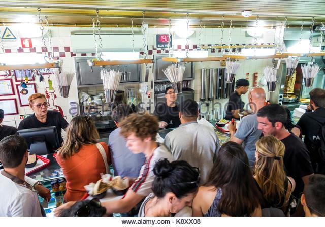 Portugal Lisbon Belem historic district Rua de Belem Pao Pao Queijo Queijo restaurant sandwich shop fast food crowded - Stock Image