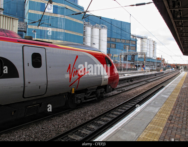 Virgin Pendo Pendolino train standing at platform three, Warrington Bank Quay railway station, Parker St, Warrington, - Stock Image