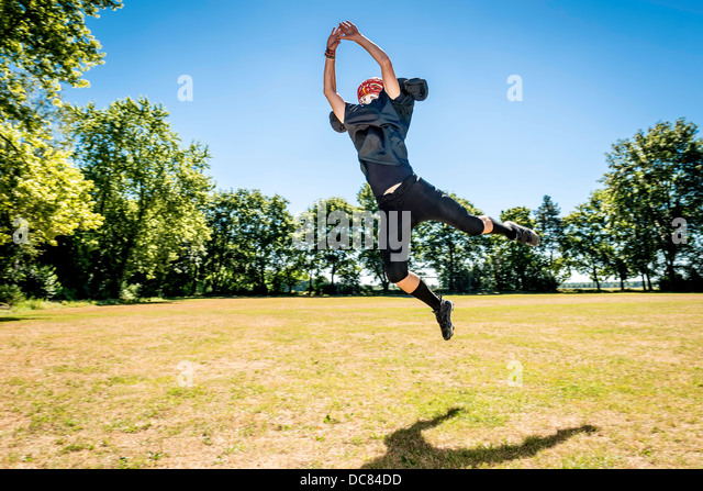 Picture of a jumping American Football Player - Stock Image