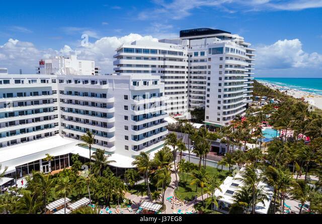 Miami Beach Florida sand Atlantic Ocean surf overhead aerial view Faena House luxury condominium hotel - Stock Image