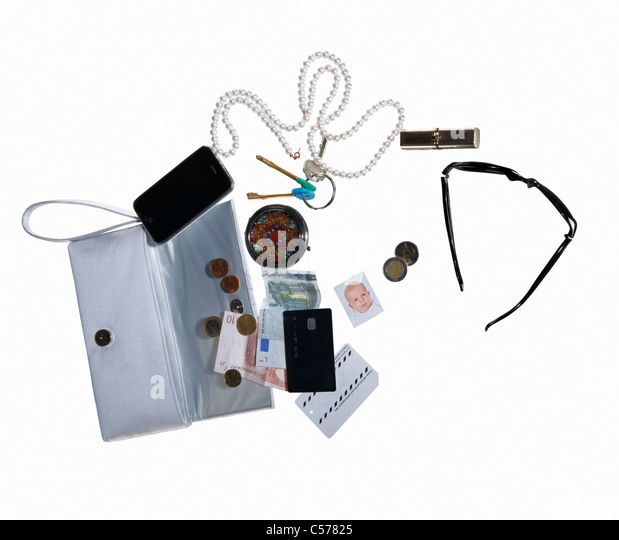 Purse with cell phone, money, jewelry - Stock Image