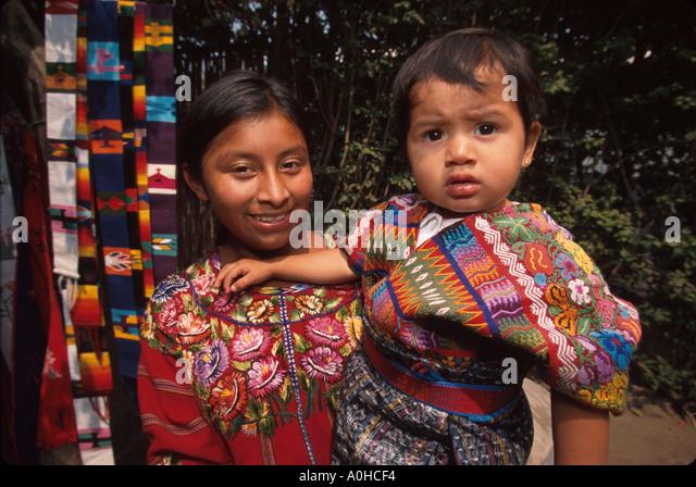 Guatemala La Antigua colonial capitol until earthquake Cakchiquel Indigenous family handicrafts - Stock Image