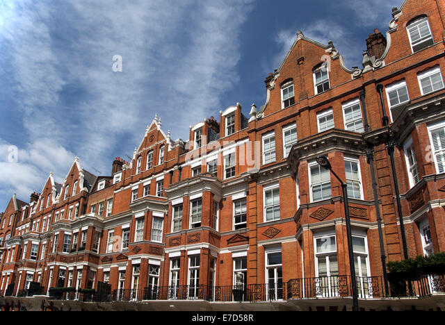 row of red brick apartments in mayfair stock photos row